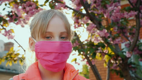 Girl-In-Pink-Protective-Mask-Against-Cherry-Blossoms-1