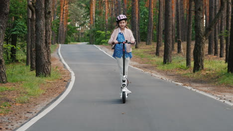 Girl-Rides-Electric-Scooter-On-The-Way-To-The-Park