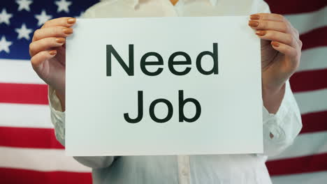 Women-s-Hands-Hold-Poster-Needed-Work-Amid-American-Flag