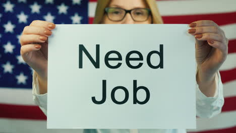 Woman-Holding-A-Poster-That-States-Need-Job