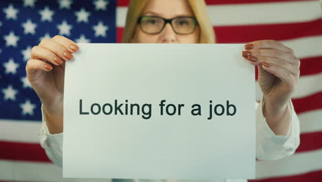 Woman-Holding-A-Poster-That-States-Looking-For-A-Job