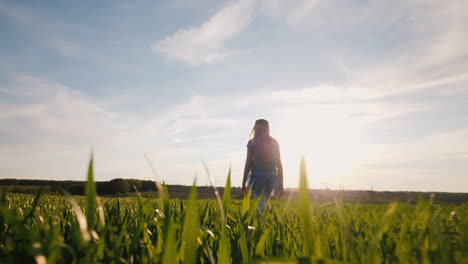 A-Girl-Walks-Along-In-The-Rays-Of-The-Setting-Sun