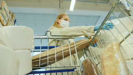 Woman-In-Protective-Mask-Buys-Toilet-Paper-In-Supermarket