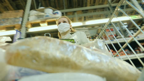 Shopper-At-Grocery-Store-Wears-Protective-Mask-Shopping-During-Coronavirus-Pandemic