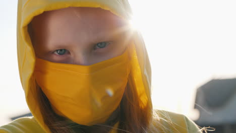 Portrait-Of-A-Girl-In-A-Yellow-Hood-And-A-Yellow-Protective-Mask-1