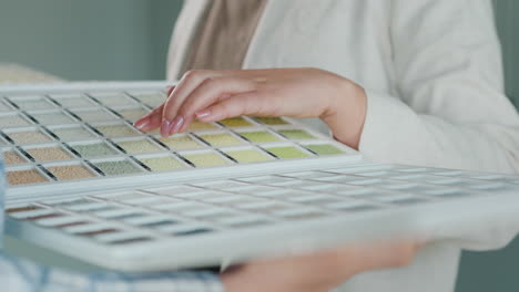 The-Woman-Chooses-The-Paint-While-The-Seller-Shows-Her-Catalog-With-Samples-1