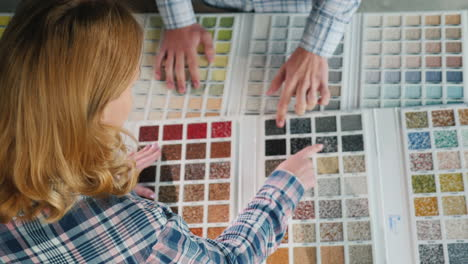 A-Group-Of-Designers-Are-Working-On-A-Color-Solution-Using-A-Catalogue-Of-Samples-1