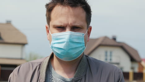 Portrait-Of-A-Young-Man-In-A-Protective-Medical-Mask-1