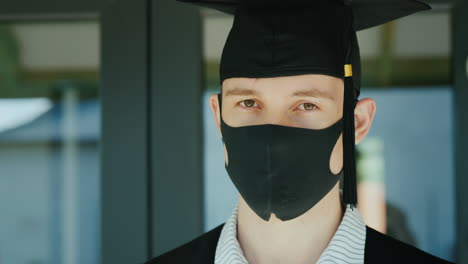 Graduate-In-A-Protective-Mask-And-Cap-Graduating-From-College-Under-Quarantine