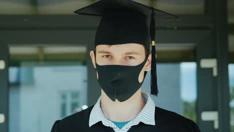 Portrait-Of-A-Man-In-A-Cap-And-Robe-And-A-Protective-Mask-On-His-Face