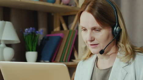 The-Woman-Communicates-With-Customers-From-Home-By-Speaking-Into-The-Headset-1