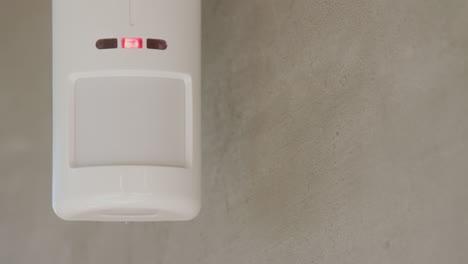 Security-alarm-sensor-on-the-wall-of-a-house-1