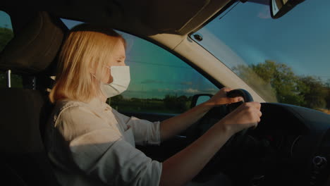 Driver-in-protective-mask-drives-behind-the-wheel-of-a-car-1