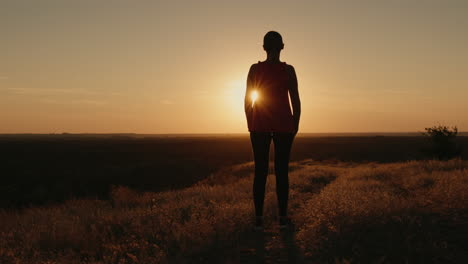 Slender-woman-silhouette-in-the-setting-sun
