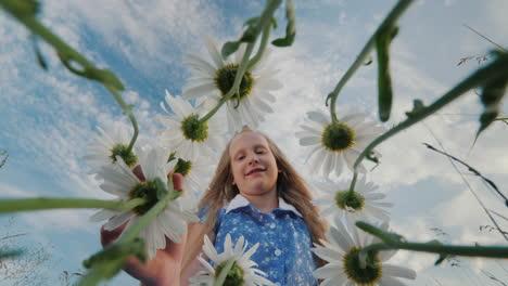 Child-admires-wildflowers