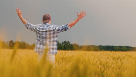 Farmer-Admires-A-Field-Of-Wheat-At-Sunset-2