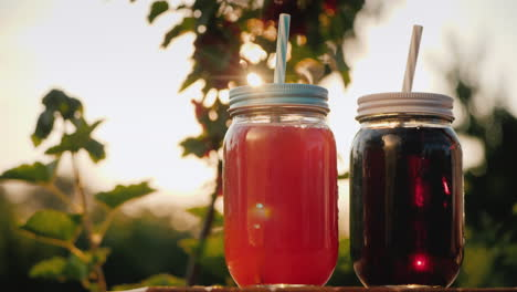 A-Woman-Puts-Two-Fruit-Soft-Drinks-On-The-Table
