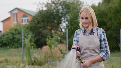 A-woman-watering-plants-in-her-garden