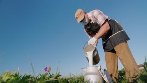 A-man-in-a-protective-mask-and-gloves-pours-milk-into-a-can-1