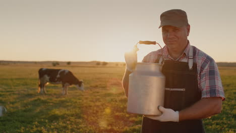 Portrait-of-a-milkman-with-a-milk-can-against-the-background-of-the-meadow