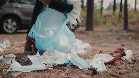 Volunteer-picks-up-garbage-in-a-forest