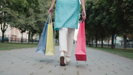 A-young-woman-carries-shopping-bags-from-fashion-stores