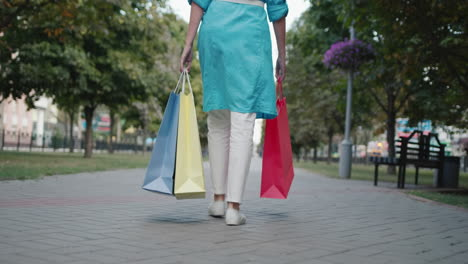 Woman-carries-shopping-bags
