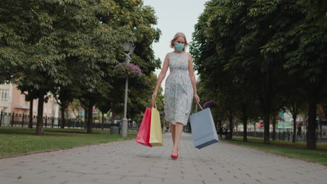 A-woman-in-red-high-heeled-shoes-carries-shopping-bags-1