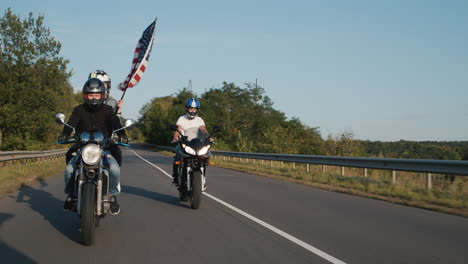 Young-bikers-drive-on-highway