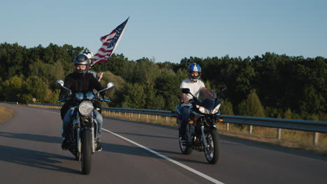 Young-bikers-drive-on-highway-1