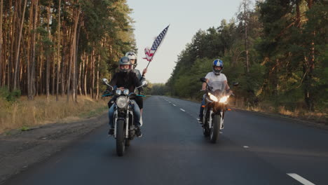 Young-bikers-drive-along-the-highway