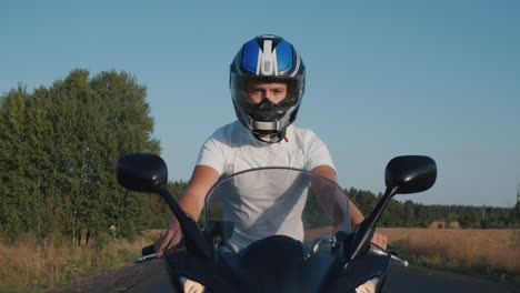 Young-man-rides-a-motorcycle-on-the-highway