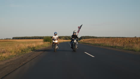 Young-bikers-drive-along-the-highway-1
