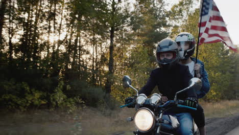 Young-biker-with-girlfriend-rides-a-motorcycle-in-the-sun