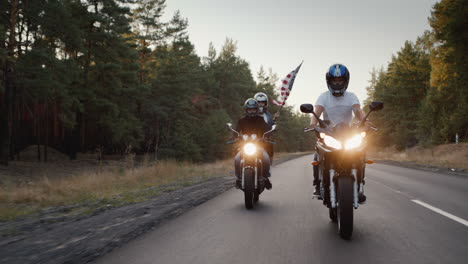 Young-people-on-high-speed-motorcycles-ride-on-the-highway
