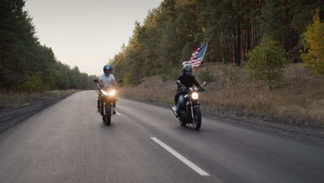 Young-people-on-high-speed-motorcycles-ride-on-the-highway-1