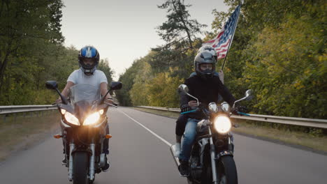 Young-people-on-high-speed-motorcycles-ride-on-the-highway-2