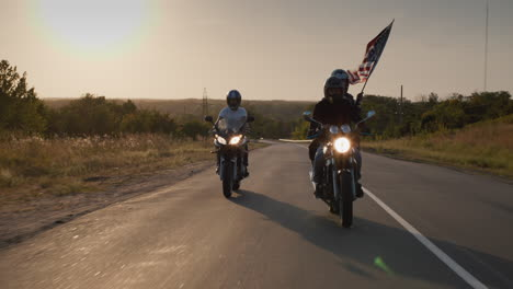 A-group-of-bikers-rides-on-the-highway-at-sunset