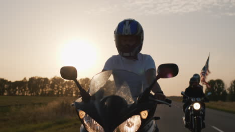 Young-people-on-high-speed-motorcycles-ride-on-the-highway-3