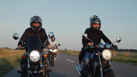 A-group-of-bikers-drives-along-the-highway-among-the-fields-on-a-clear-autumn-day-1
