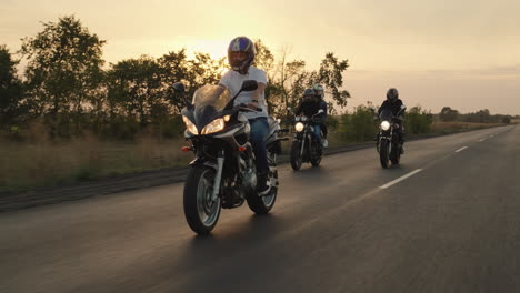 A-group-of-bikers-ride-on-motorcycles-on-the-highway-1