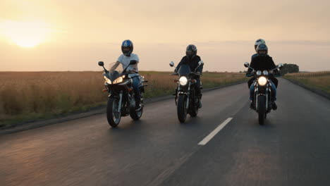 A-group-of-bikers-rides-on-the-highway-in-the-evening-at-sunset-1