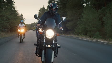 Bikers-ride-on-the-road-among-the-pine-forest