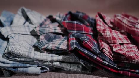 Gently-folded-shirts-lie-on-the-shelf