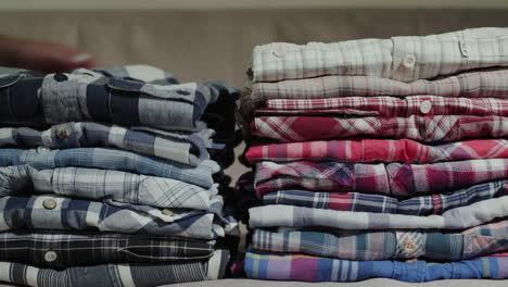 Women-s-hands-put-men-s-shirts-in-a-neat-pile