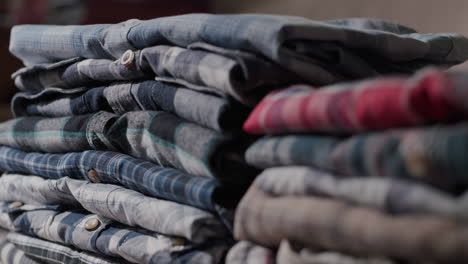 Women-s-hands-put-men-s-shirts-in-a-neat-pile-2