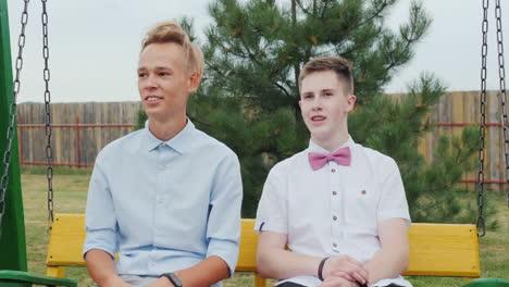 Two-high-school-graduates-ride-on-a-swing