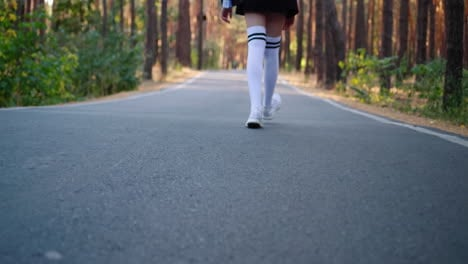A-child-s-legs-and-on-the-way-to-the-woods-alone