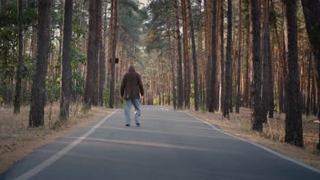 Drunk-homeless-man-walks-on-the-road-in-the-park