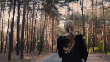 A-cheerful-girl-with-a-school-bag-runs-through-the-park